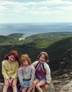 My sisters and I on Cadillac Mountain, with Sand Beach in the background. Mount Desert Island. I'm the one on far right.